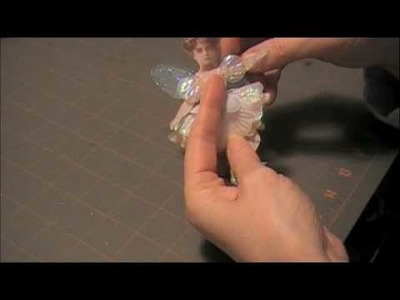 Creating a mixed media, altered art, flower fairy paper art doll.