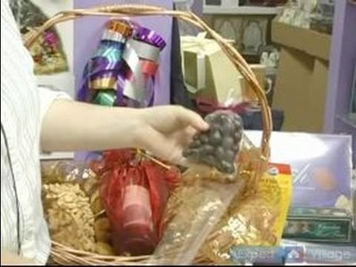 How To Make Elegant Gift Baskets : How To Place Wrapped Chocolates in a Gift Basket