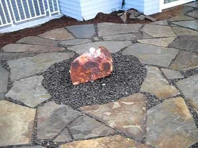 Raised Patio with Rock Bubbler by Creative Cascades