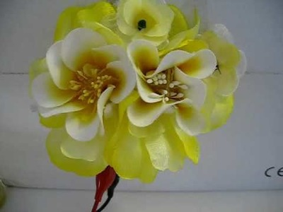 Flower brooch with shape alloy memory wire