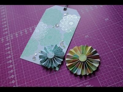 Cómo hacer una roseta de papel. How to make a paper rosette