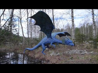 Flying paper mache dragon sculpture