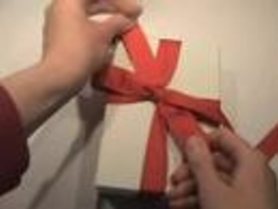 Tying a bow on a gift box