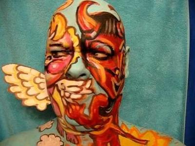 Devil or Angel? Face paint art in motion Video. Artist James Kuhn.