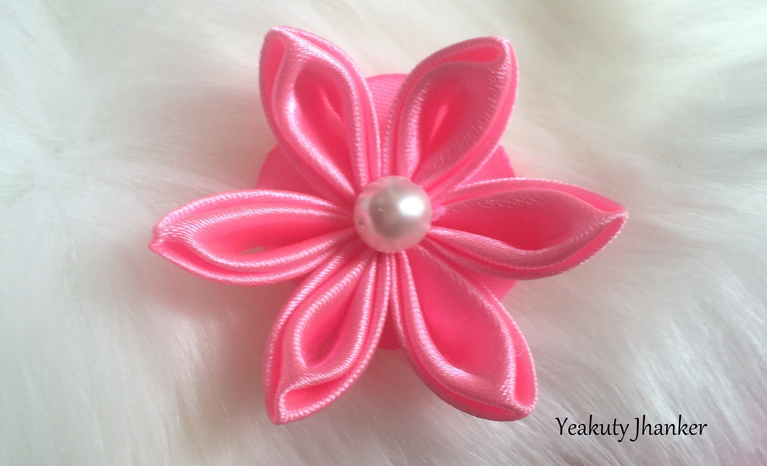 DIY: How to make a Kanzashi ribbon flower.