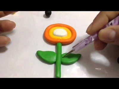 Super Mario Bros - Fire Flower: polymer clay tutorial. !