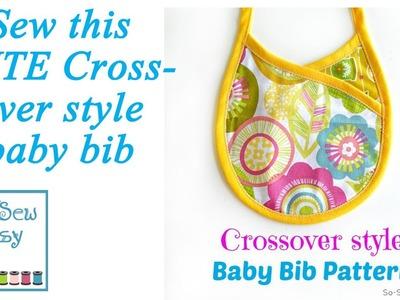 Crossover baby bib
