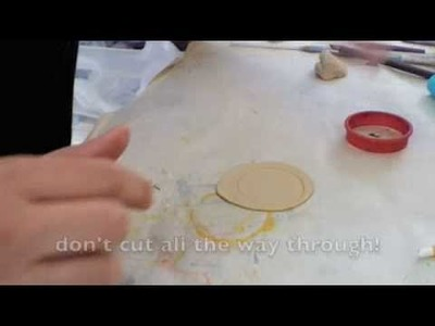 How to use rubber stamps and clay to make a pendant