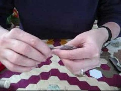 2) demonstration hand sewing patchwork hexagons together