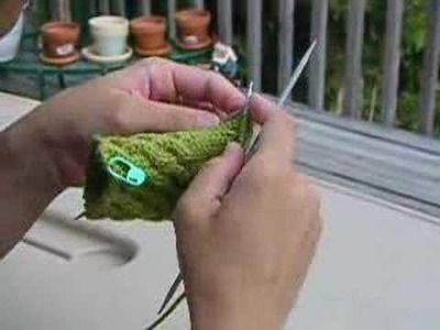 Me knitting a Fetching glove!