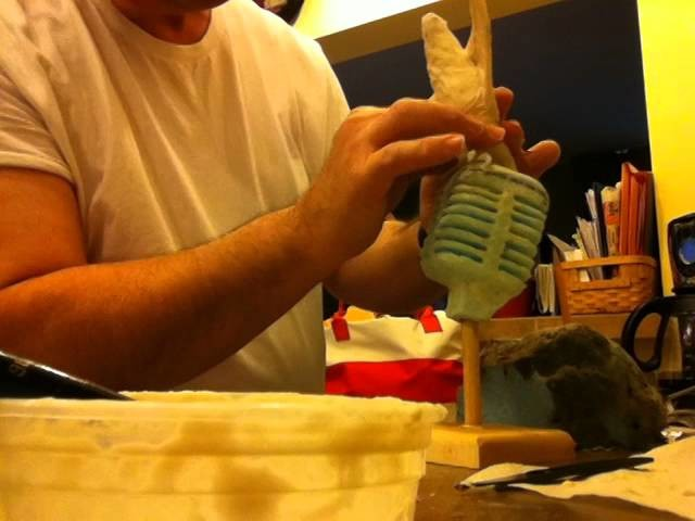 Paper mâché bird on microphone slower timelapse