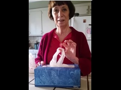 Lady Stores Plastic Grocery Bags so they Pop Up in Tissue Box
