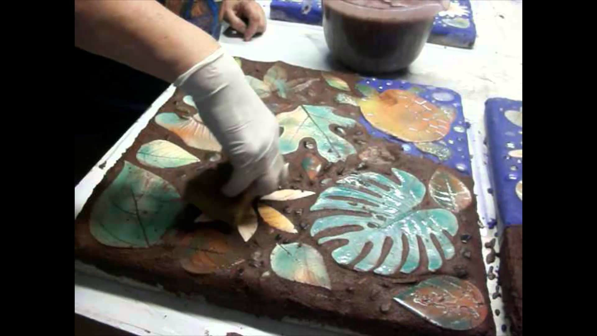 Handmade pottery tiles for garden mosaic