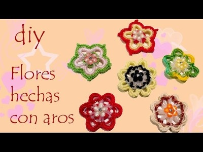 Flores hechas con aros de plastico Flowers made with plastic rings
