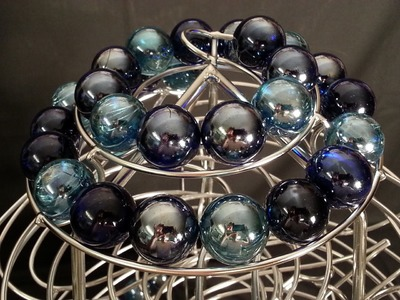 Perpetuum mobile rolling ball sculpture