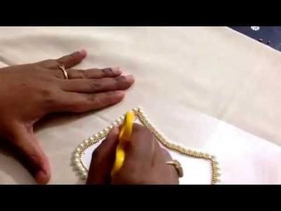 DIY a flower shaped pearl and kundan rangoli for diwali