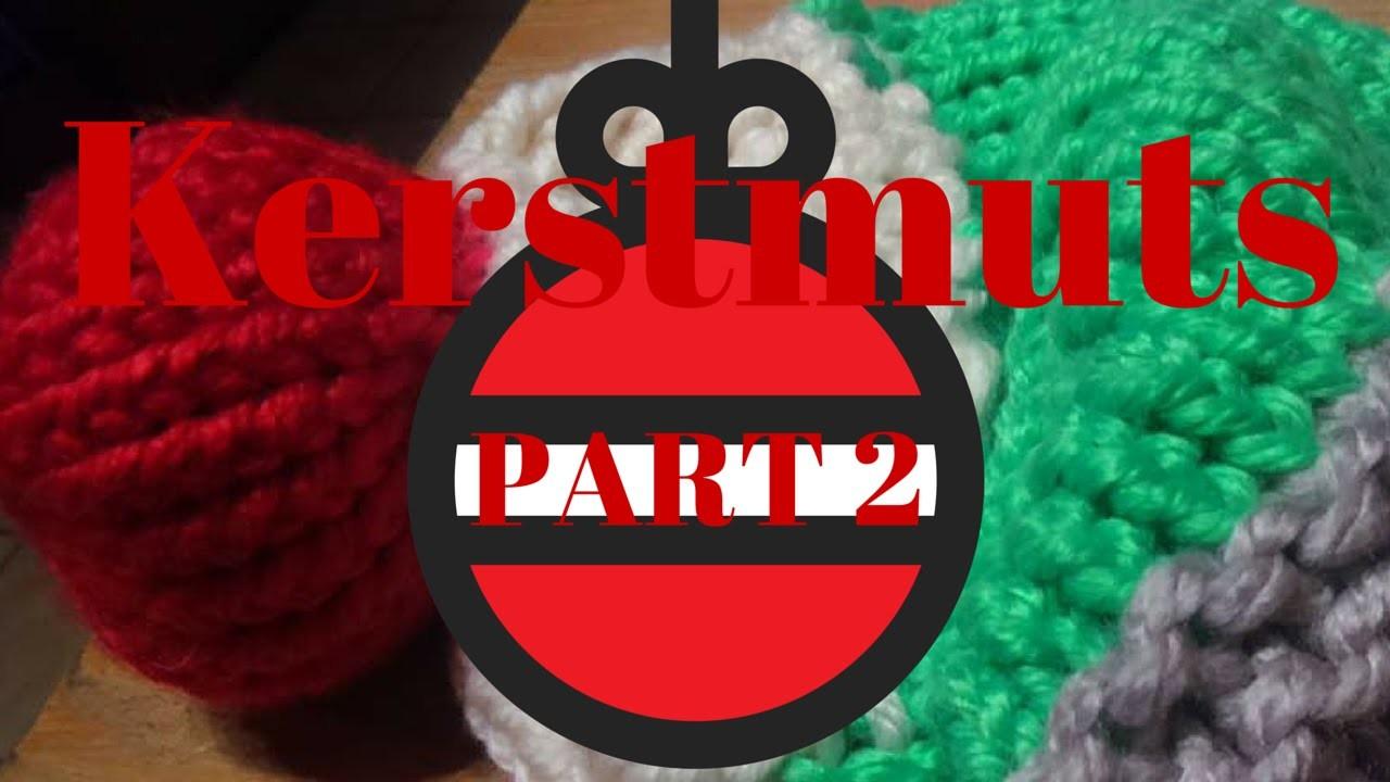 A red ball on a loom. Een rode bal op een breiring.
