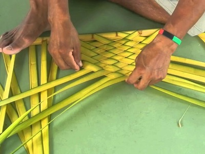 Weaving palm fronds