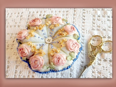 How to embroider a silk ribbon pincushion using an embroiderers background