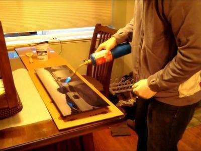 Brad doing Epoxy Resin Coating on Metallic Print