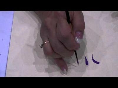 Jill Fitzhenry demonstrates the Black Gold Round brush strokes