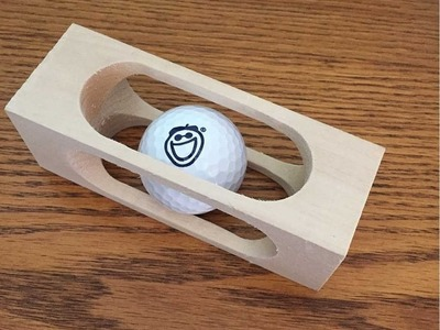 Mystery Golf Ball in a Block of Wood (WoodLogger.com)