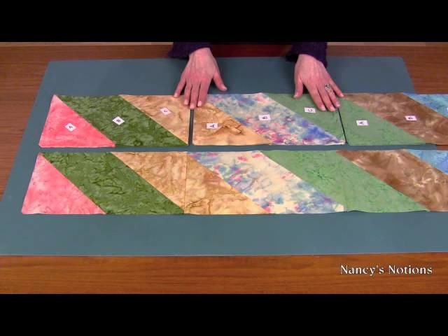 Create an impressive quilt top with fabric strips and straight stitches