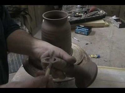 THROWING A WATERING CAN ON THE WHEEL PART 2.wmv