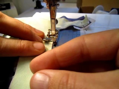 Sewing the Fingertips of Glove (Close-up)