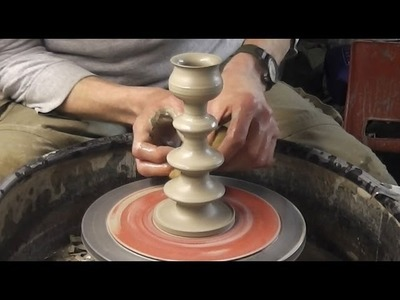 Making. throwing a Pottery Candlestick on the wheel