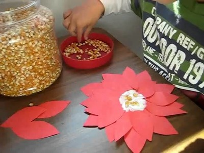 Christmas. Arts and Crafts activity: Red color paper and popcorn poinsetta flowers.