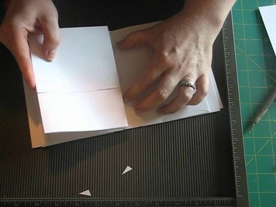 Kathy Orta's envelope mini album with a chipbord spine tutorial 3