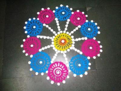 How to make beautiful flowers in easy rangoli design - created by latest rangoli