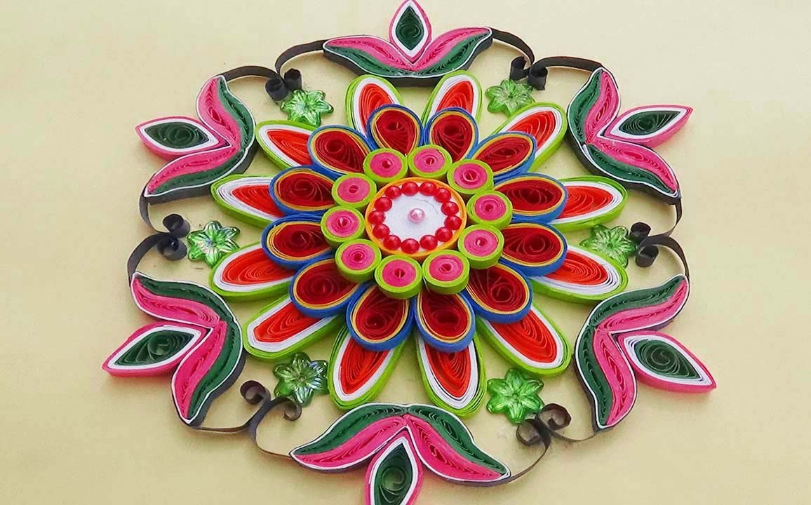 Paper quilling easy and simple rangoli using flowers for Simple paper quilling designs