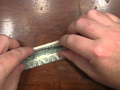 Origami Canoe with a US dollar bill