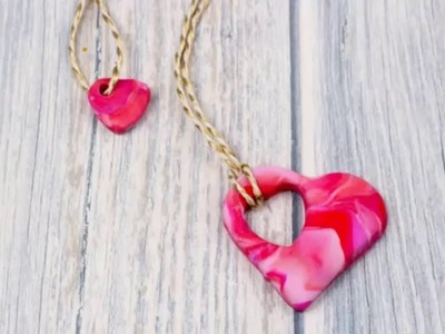 Polymer clay mother and child heart necklace