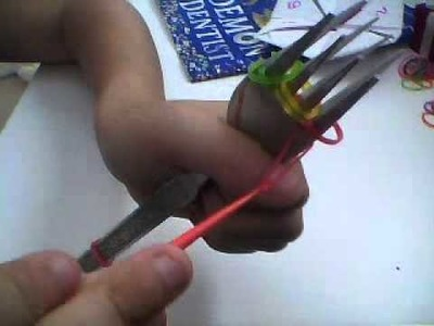 How to make a triple single loom band bracelet on 2 forks