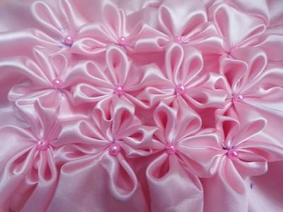 8 petal flower smocking pattern on a fabric
