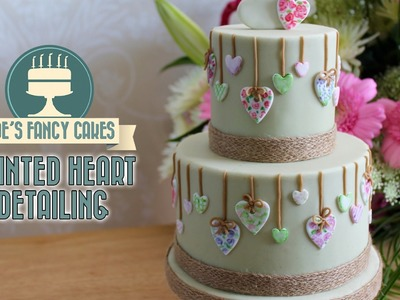 Painted heart detailing on a cake