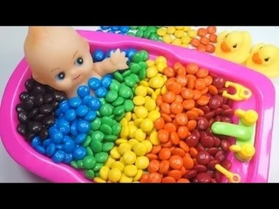 Doll Bath Learn colors of M&M's Chocolate candies. Children's songs and rhymes!