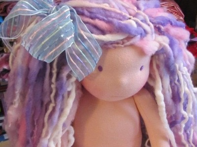 """Waldorf doll head tying the chin line and making """"chubby cheeks"""" on the dolls face"""