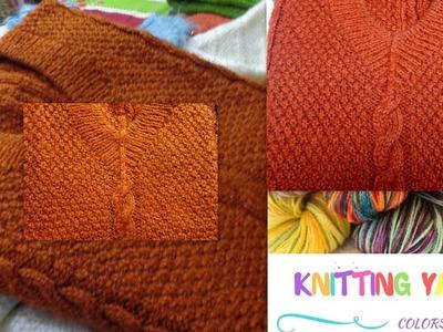 Cable knitting pattern on orange sweater (Hindi)