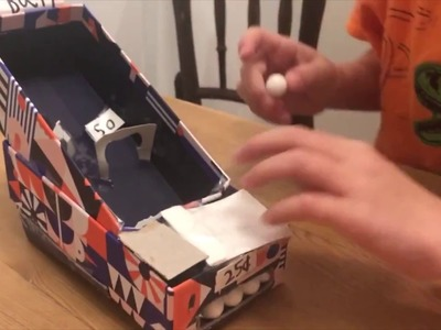 DIY Skee Ball game with a Warby Parker box