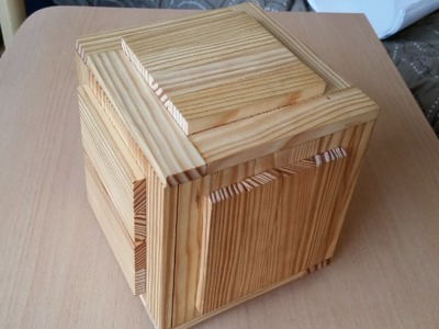 Wooden puzzle boxes with two secret compartments
