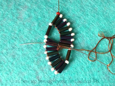 Double wave bugle bracelet with beaded clasp