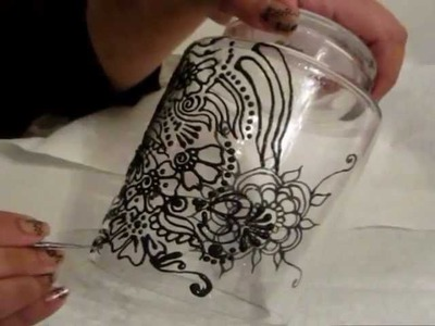 Henna design on glass with glass painting.