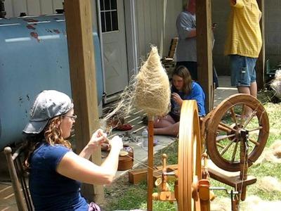 Spinning flax on wheel