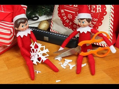 Elf on the Shelf makes paper snowflakes - origami