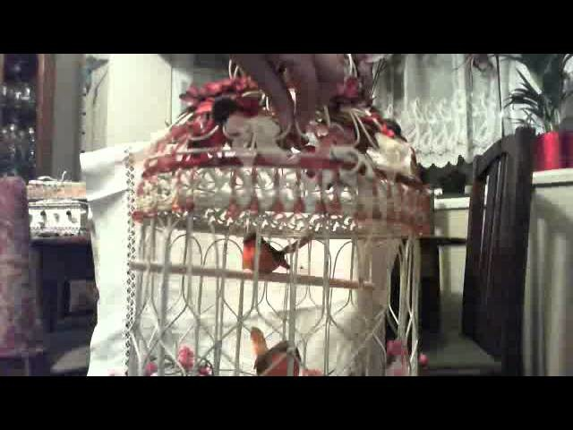 Shabby chic decorated bird cage with lights
