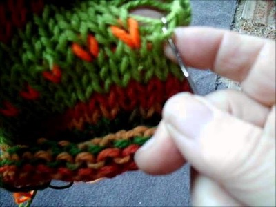 Fixing a column of stitches that tucked accidentally failed to knit off
